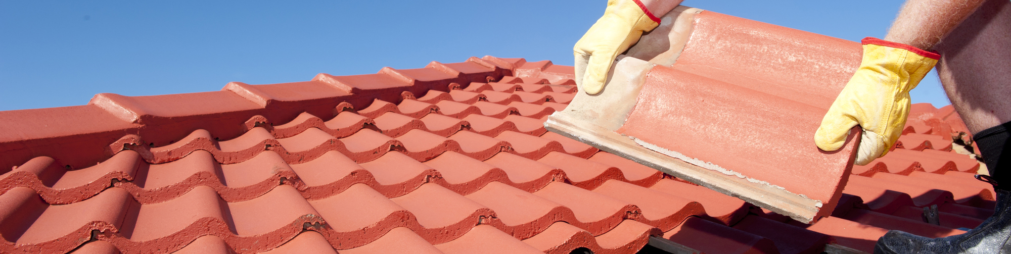 Man placing tile roof
